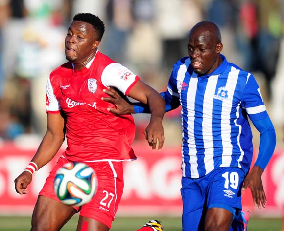 Terrence Mandaza of Maritzburg United battles Themba Shabalala of Free State Stars during the Absa Premiership 2014/15 football match between Free State Stars and Maritzburg United at the Goble Park Stadium in Bethlehem , Free State Province on the 30th of August 2014