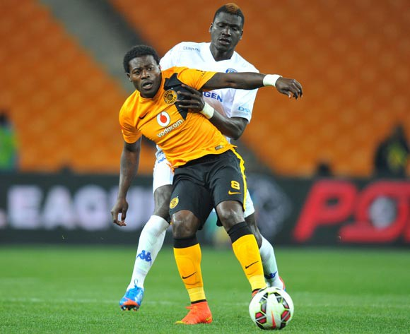 Kingston Nkhatha of Kaizer Chiefs challenged by Mor Diouf of Supersport United during the Absa Premiership match between Kaizer Chiefs and Supersport United at FNB Stadium on the 30 August 2014