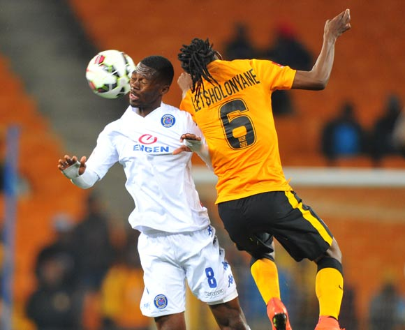 Thato Mokeke of Supersport United challenged by Reneilwe Letsholonyane of Kaizer Chiefs during the Absa Premiership match between Kaizer Chiefs and Supersport United at FNB Stadium on the 30 August 2014