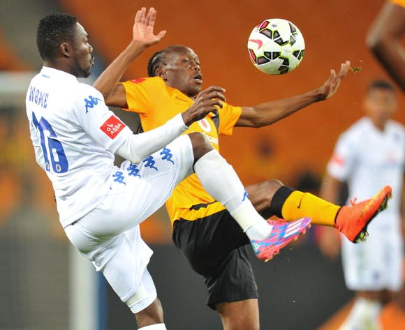 Dove Wome of Supersport United challenged by Reneilwe Letsholonyane of Kaizer Chiefs during the Absa Premiership match between Kaizer Chiefs and Supersport United at FNB Stadium on the 30 August 2014