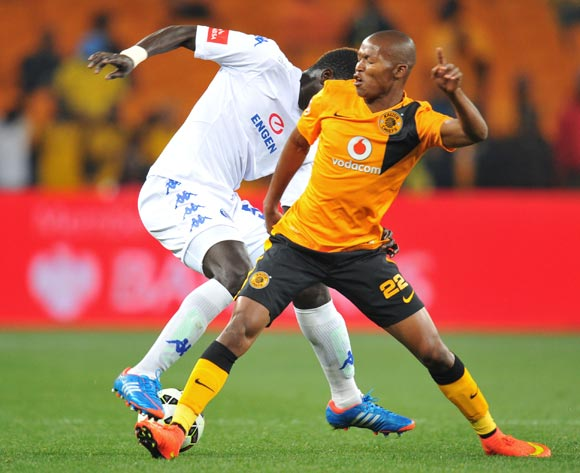 Mor Diouf of Supersport United challenged by Mandla Masango of Kaizer Chiefs during the Absa Premiership match between Kaizer Chiefs and Supersport United at FNB Stadium on the 30 August 2014