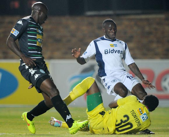 Onismor Bhasera of Bidvest Wits tackled by Patrick Tignyemb of Bloemfontein Celtic during the 2014 MTN 8 Quarter Final match between Bidvest Wits and Bloemfontein Celtic at Bidvest Stadium,  Johannesburg on the 01 August  2014