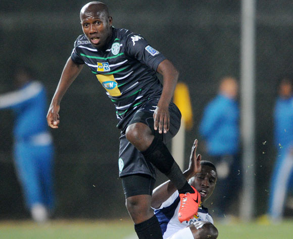 Tumelo Mogapi of Bloemfontein Celtic tackled by Siyabonga Nhlapho of Bidvest Wits during the 2014 MTN 8 Quarter Final match between Bidvest Wits and Bloemfontein Celtic at Bidvest Stadium,  Johannesburg on the 01 August  2014