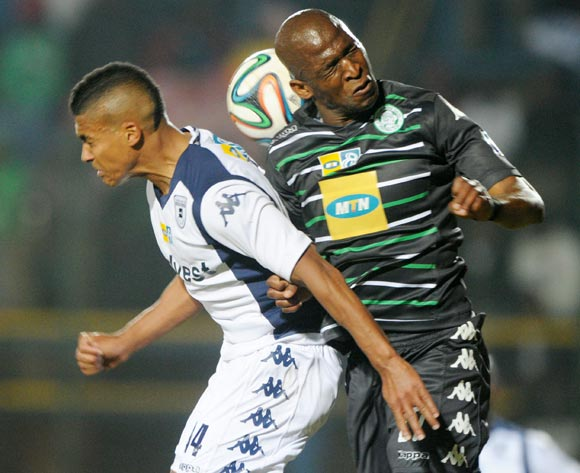 Alfred Ndengane of Bloemfontein Celtic battles with Ryan Chapman of Bidvest Wits during the 2014 MTN 8 Quarter Final match between Bidvest Wits and Bloemfontein Celtic at Bidvest Stadium,  Johannesburg on the 01 August  2014