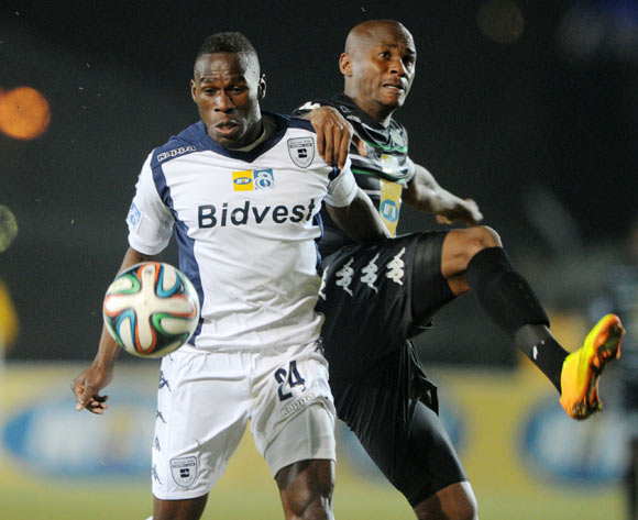 Onismor Bhasera of Bidvest Wits battles with Joel Mogorosi of Bloemfontein Celtic during the 2014 MTN 8 Quarter Final match between Bidvest Wits and Bloemfontein Celtic at Bidvest Stadium,  Johannesburg on the 01 August  2014