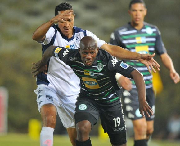 Tumelo Mogapi of Bloemfontein Celtic challenged by Henrico Botes of Bidvest Wits during the MTN8 Quarter final match between Bidvest Wits and Bloemfontein Celtic at the Bidvest Stadium, Johannesburg on the 01 August 2014