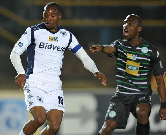 Sibusiso Vilakazi of Bidvest Wits challenged by Alfred Ndengane of Bloemfontein Celtic during the MTN8 Quarter final match between Bidvest Wits and Bloemfontein Celtic at the Bidvest Stadium, Johannesburg on the 01 August 2014
