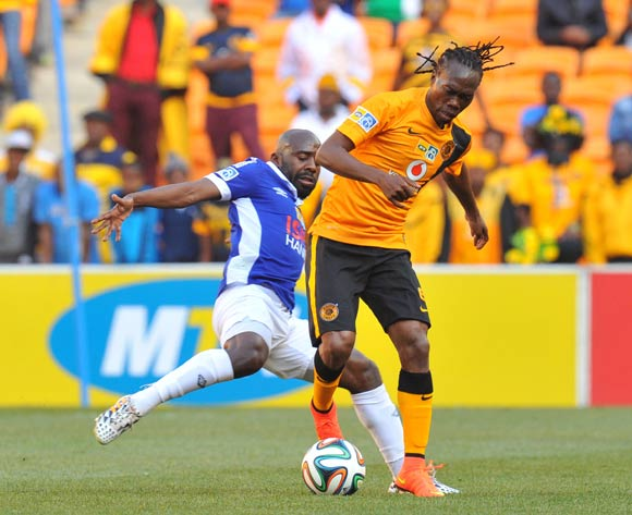 Reneilwe Letsholonyane of Kaizer Chiefs challenged by Sandile Zuke of Black Aces during the 2014 MTN8 Quarter final match between Kaizer Chiefs and Black Aces at the FNB Stadium, Johannesburg on the 03 August 2014