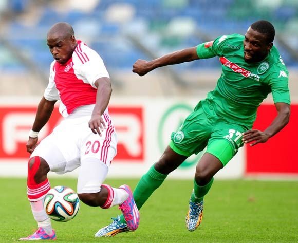Thabiso Nkoana of Ajax Cape Town battles Willem Mwedihanga of AmaZulu during the Absa Premiership 2014/15 football match between AmaZulu and Ajax Cape Town at the Moses Mabhida Stadium in Durban , Kwa-Zulu Natal on the 10th of August 2014