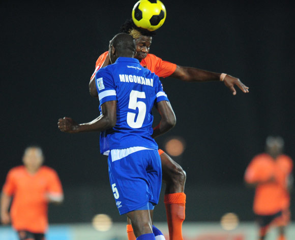 Siphesihle Nzimande of Polokwane City battles Kwanda Mngonyama of Maritzburg United during the Absa Premiership 2014/15 football match between Maritzburg United and Polokwane City at the Harry Gwala Stadium in Pietermaritzburg , Kwa-Zulu Natal on the 13th of August 2014