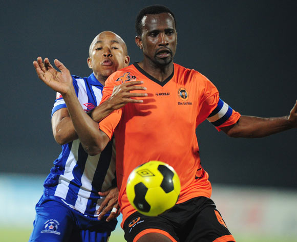 Thapelo Tshilo of Polokwane City and Kurt Lentjies of Maritzburg United during the Absa Premiership 2014/15 football match between Maritzburg United and Polokwane City at the Harry Gwala Stadium in Pietermaritzburg , Kwa-Zulu Natal on the 13th of August 2014