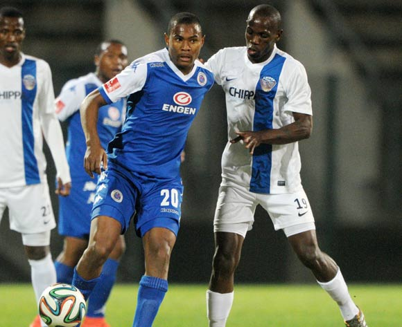 Prince Nxumalo of Supersport United challenged by Bheki Nzunga of Chippa United during the Absa Premiership 2014/15 match between Supersport United and Chippa United at Lucas Moripe Stadium,  Attridgeville on the 12 August  2014