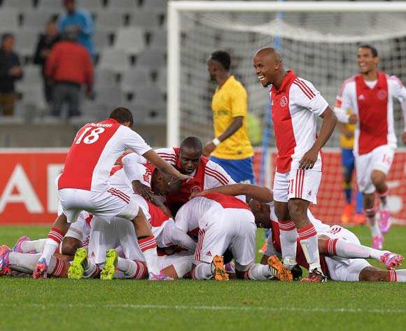 Travis Graham of Ajax Cape Town celebrates his goal with his teammates during the Absa Premiership 2014/15 football match between Ajax Cape Town and Mamelodi Sundowns at Cape Town Stadium, Cape Town on 13 August 2014