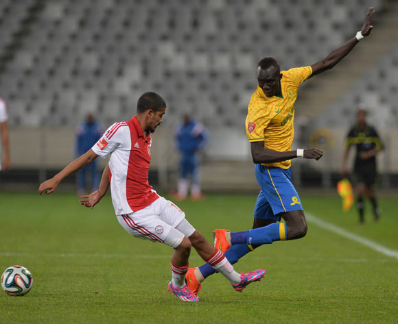 Mame Niang of Mamelodi Sundowns back heels a pass pat Abbubaker Mobara of Ajax Cape Town during the Absa Premiership 2014/15 football match between Ajax Cape Town and Mamelodi Sundowns at Cape Town Stadium, Cape Town on 13 August 2014