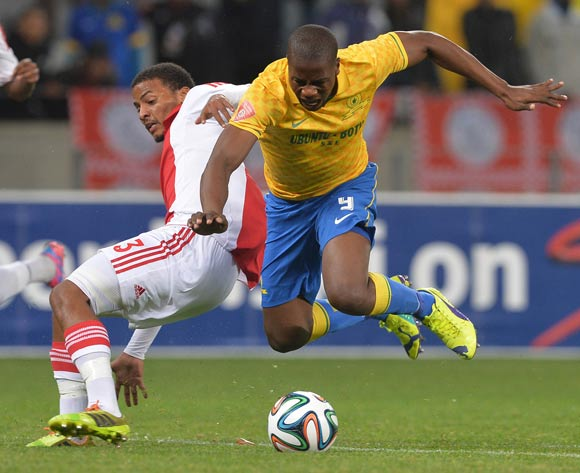 Bongi Ntuli of Mamelodi Sundowns battles for the ball with Rivaldo Coetzee of Ajax Cape Town during the Absa Premiership 2014/15 football match between Ajax Cape Town and Mamelodi Sundowns at Cape Town Stadium, Cape Town on 13 August 2014