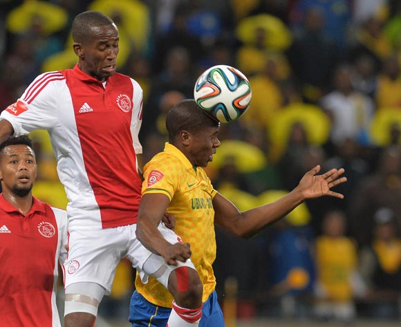Bongi Ntuli of Mamelodi Sundowns battles for the ball with Mosa Lebusa of Ajax Cape Town during the Absa Premiership 2014/15 football match between Ajax Cape Town and Mamelodi Sundowns at Cape Town Stadium, Cape Town on 13 August 2014