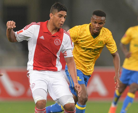 Travis Graham of Ajax Cape Town evades challenge from Themba Zwane of Mamelodi Sundowns during the Absa Premiership 2014/15 football match between Ajax Cape Town and Mamelodi Sundowns at Cape Town Stadium, Cape Town on 13 August 2014