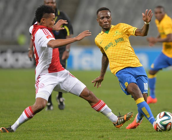 Teko Modise of Mamelodi Sundowns evades challenge from Granwald Scott of Ajax Cape Town during the Absa Premiership 2014/15 football match between Ajax Cape Town and Mamelodi Sundowns at Cape Town Stadium, Cape Town on 13 August 2014