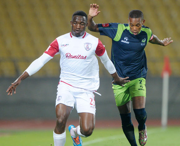 Moeketsi Sekola of Free State Stars challenged by Vuyo Mere of Platinum Stars during the Absa Premiership 2014/15 match between Platinum Stars and Free State Stars at Royal Bafokeng Stadium,  Rustenburg on the 13 August  2014