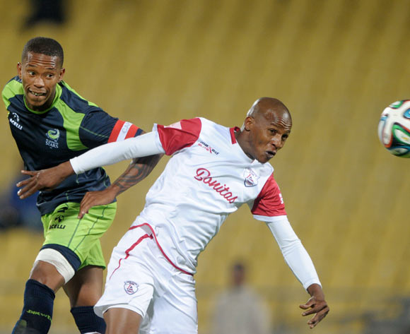 Richard Henyekane of Free State Stars battles with Vuyo Mere of Platinum Stars during the Absa Premiership 2014/15 match between Platinum Stars and Free State Stars at Royal Bafokeng Stadium,  Rustenburg on the 13 August  2014