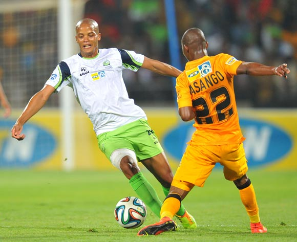 Solomon Mathe of Platinum Stars challenged by Mandla Masango of Kaizer Chiefs during the 2014 MTN 8 Semi Final first leg match between Platinum Stars and Kaizer Chiefs at Royal Bafokeng Stadium on the 16 August 2014