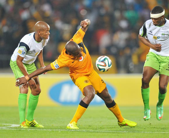 Willard Katsande of Kaizer Chiefs challenged by Solomon Mathe and Ndumiso Mabena of Platinum Stars during the 2014 MTN 8 Semi Final first leg match between Platinum Stars and Kaizer Chiefs at Royal Bafokeng Stadium on the 16 August 2014