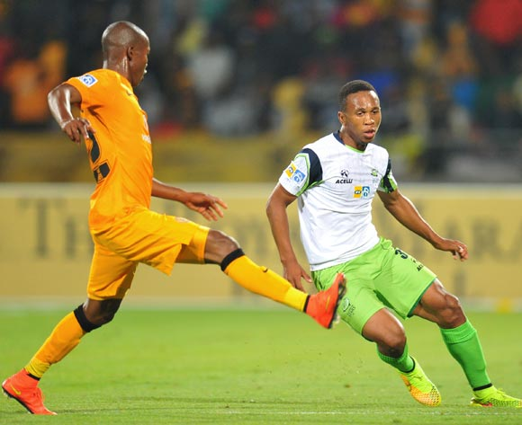 Luvolwethu Mpeta of Platinum Stars challenged by Mandla Masango of Kaizer Chiefs during the 2014 MTN 8 Semi Final first leg match between Platinum Stars and Kaizer Chiefs at Royal Bafokeng Stadium on the 16 August 2014
