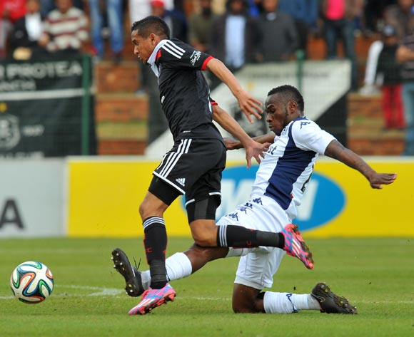 Daine Klate of Orlando Pirates tackled by Onismor Bhasera of Bidvest Wits during the 2014 MTN 8 Semi Final first leg match between Bidvest Wits and Orlando Pirates at Bidvest Stadium on the 17 August 2014