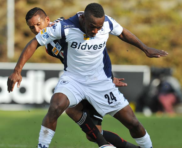Onismor Bhasera of Bidvest Wits challenged by Daine Klate of Orlando Pirates during the 2014 MTN 8 Semi Final first leg match between Bidvest Wits and Orlando Pirates at Bidvest Stadium on the 17 August 2014