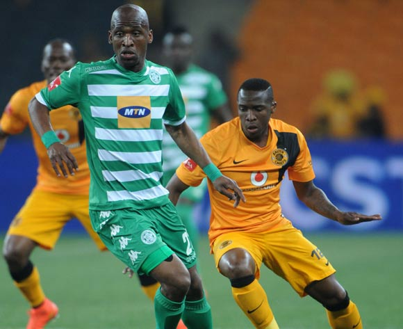 Alfred Ndengane of Bloemfontein Celtic challenged by George Maluleka of Kaizer Chiefs during the Absa Premiership 2014/15 match between Kaizer Chiefs and Bloemfontein Celtic at FNB Stadium,  Johannesburg on the 19 August  2014