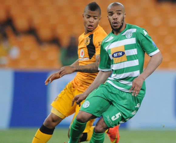 Wandisile Letlabika of Bloemfontein Celtic challenged by George Lebese of Kaizer Chiefs during the Absa Premiership 2014/15 match between Kaizer Chiefs and Bloemfontein Celtic at FNB Stadium,  Johannesburg on the 19 August  2014