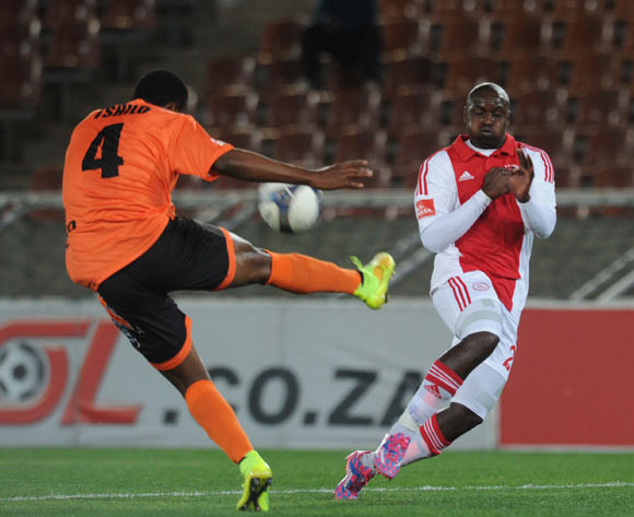 Thabiso Nkoana of Ajax Cape Town tussles with Thapelo Tshilo of Polokwane City during Absa Premiership match between Polokwane City and Ajax Cape Town on the 19 August 2014 at Peter Mokaba Stadium