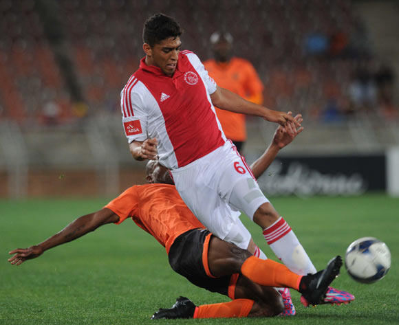 Travis Graham of Ajax Cape Town tussles with Tlou Molekwane of Polokwane City during Absa Premiership match between Polokwane City and Ajax Cape Town on the 19 August 2014 at Peter Mokaba Stadium