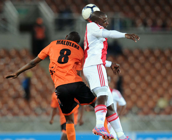 Thabiso Nkoana of Ajax Cape Town tussles with Jabu Maluleke of Polokwane City during Absa Premiership match between Polokwane City and Ajax Cape Town on the 19 August 2014 at Peter Mokaba Stadium