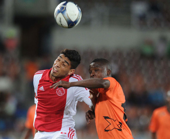 Travis Graham of Ajax Cape Town tussles with Linda Shiba of Polokwane City during Absa Premiership match between Polokwane City and Ajax Cape Town on the 19 August 2014 at Peter Mokaba Stadium