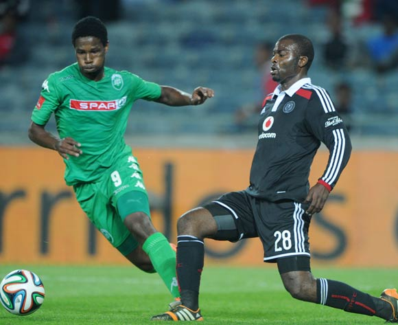 Rooi Mahamutsa of Orlando Pirates challenged by Bongani Ndulula of Amazulu during the Absa Premiership 2014/15 match between Orlando Pirates and AmaZulu at Orlando Stadium,  Soweto on the 20 August  2014