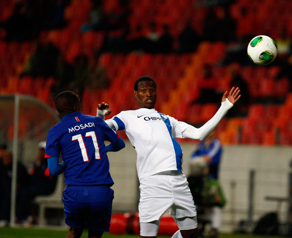 Thamsanqa Sangweni of Chippa United and Thabo Mosadi of University of Pretoria during the Absa Premiership football Match between Chippa United and The University of Pretoria at the Nelson Mandela Bay Stadium on 20 August 2014
