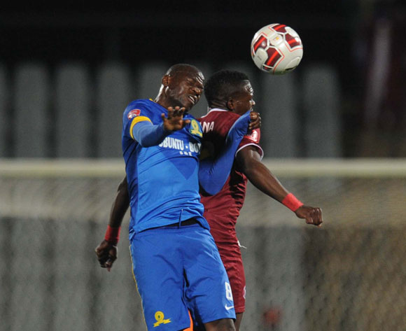 Hlompho Kekana of Mamelodi Sundowns tussles with Vuyisile Wana of Moroka Swallows during Absa Premiership match between Moroka Swallows and Mamelodi Sundowns on the 20 August 2014 at Dobsonville Stadium