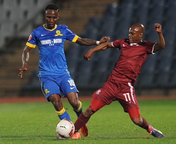 Teko Modise of Mamelodi Sundowns tussles with Dikgang Mabalane of Moroka Swallows during Absa Premiership match between Moroka Swallows and Mamelodi Sundowns on the 20 August 2014 at Dobsonville Stadium