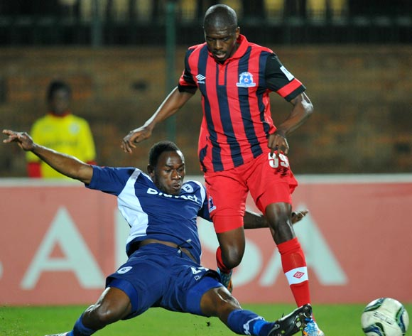 Ntuthuko Mabaso of Martizburg United tackled by Onismor Bhasera of Bidvest Wits during the Absa Premiership match between Bidvest Wits and Maritzburg United at Bidvest Stadium on the 20 August 2014
