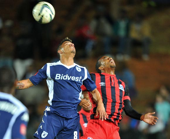 Mogammed Losper of Bidvest Wits challenged by Deolin Mekoa of Martizburg United during the Absa Premiership match between Bidvest Wits and Maritzburg United at Bidvest Stadium on the 20 August 2014