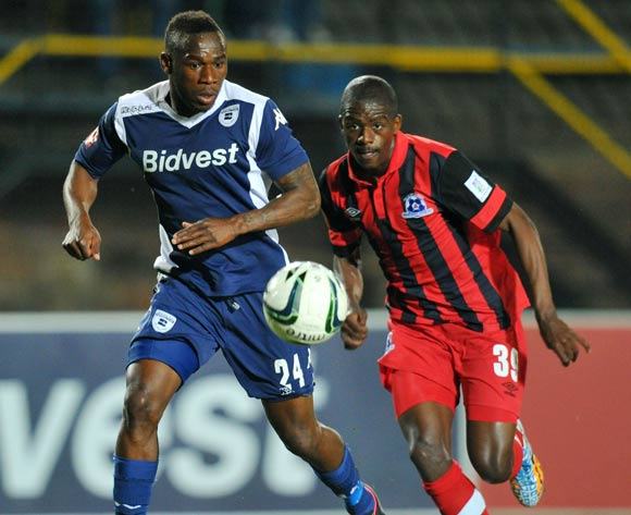 Onismor Bhasera of Bidvest Wits challenged by Ntuthuko Mabaso of Martizburg United during the Absa Premiership match between Bidvest Wits and Maritzburg United at Bidvest Stadium on the 20 August 2014