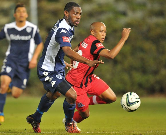 Thulani Hlatshwayo of Bidvest Wits challenged by Kurt Lentjies of Martizburg United during the Absa Premiership match between Bidvest Wits and Maritzburg United at Bidvest Stadium on the 20 August 2014