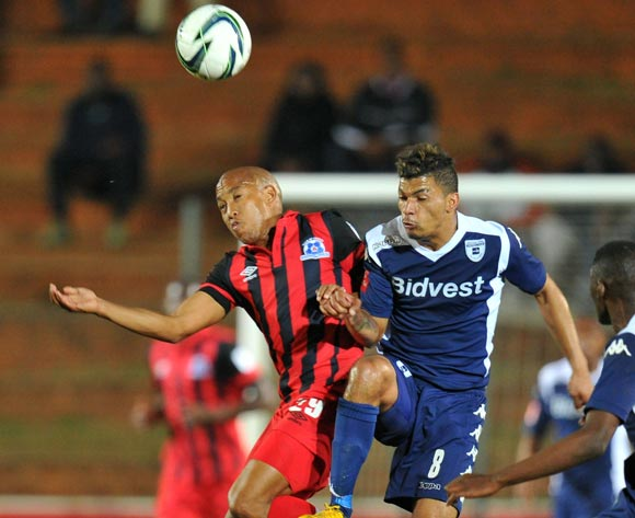 Kurt Lentjies of Martizburg United challenged by Mogammed Losper of Bidvest Wits during the Absa Premiership match between Bidvest Wits and Maritzburg United at Bidvest Stadium on the 20 August 2014