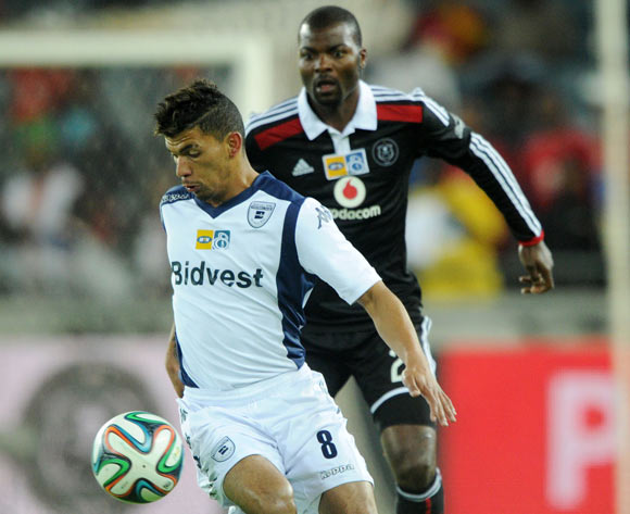 Toriq Losper of Bidvest Wits challenged by Rooi Mahamutsa of Orlando Pirates  during the 2014 MTN 8 Semi Final match between Orlando Pirates and Bidvest Wits at Orlando Stadium,  Soweto on the 23 August  2014