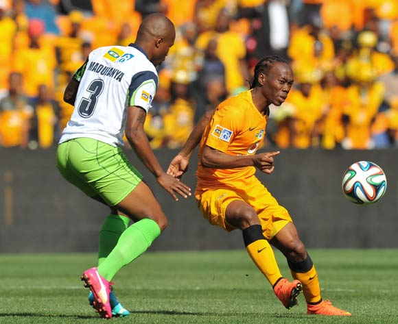 Reneilwe Letsholonyane of Kaizer Chiefs challenged by Letladi Madubanya of Platinum Stars during the 2014 MTN 8 Semi Final second leg match between Kaizer Chiefs and Platinum Stars at Orlando Stadium on the 24 August 2014