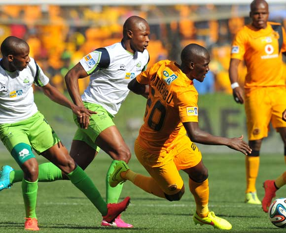 Siphelele Mthembu of Kaizer Chiefs challenged by Sibusiso Msomi of Platinum Stars during the 2014 MTN 8 Semi Final second leg match between Kaizer Chiefs and Platinum Stars at Orlando Stadium on the 24 August 2014