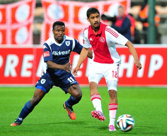 Abbubaker Mobara of Ajax Cape Town in control ahead of Christopher Katongo of Bidvest Wits  during the Absa Premiership 2014/15 game between Ajax Cape Town and Bidvest Wits at Athlone Stadium, Cape Town on 26 August 2014