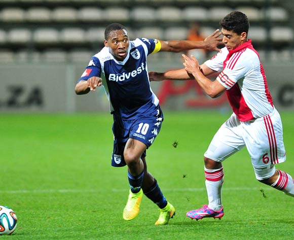 Sibusiso Vilakazi of Bidvest Wits takes Travis Graham of Ajax Cape Town during the Absa Premiership 2014/15 game between Ajax Cape Town and Bidvest Wits at Athlone Stadium, Cape Town on 26 August 2014