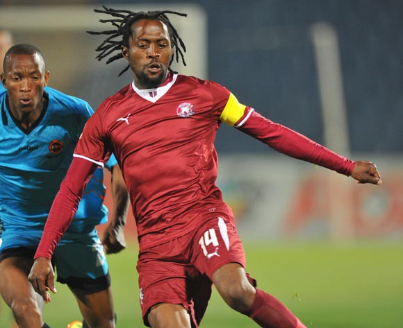 Lerato Chabangu of Moroka Swallows challenged by Sifiso Mbhele of Polokwane City during the Absa Premiership match between Moroka Swallows and Polokwane City at Dobsonville on the 26 August 2014